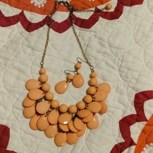 Peachy-pink statement necklace & earings